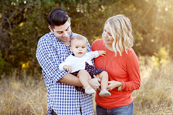 Family photo session with one year old baby in orange and navy blue clothes