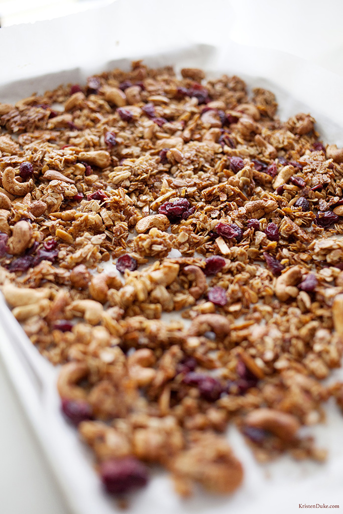 cranberry cashew granola on baking sheet
