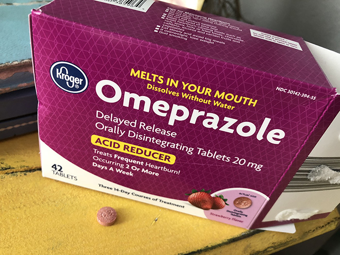 box of omeprazole acid reflux medicine
