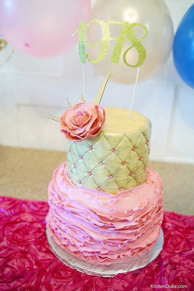 pink and gold decorated cake