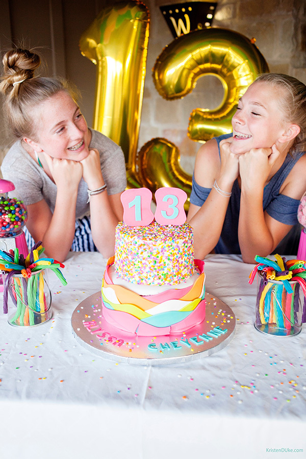 birthday girls posing with their cake