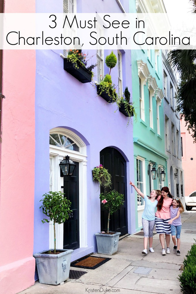 mother and daughters walking in front of colorful houses in Charleston South Carolina
