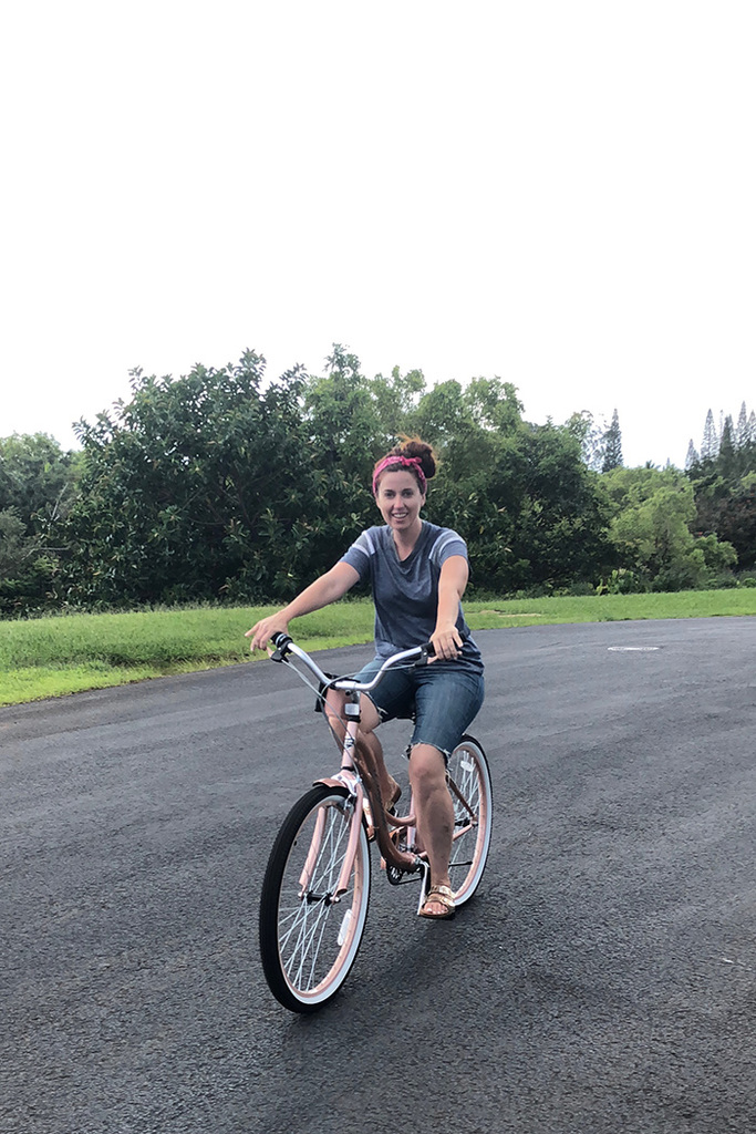 woman riding a bike in kauai hawaii