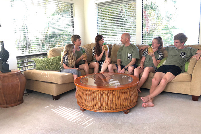 family on a couch in kauai vacation rental