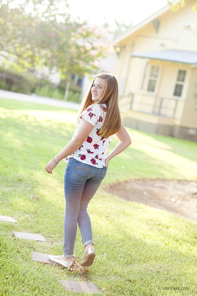 teen girl in rose tee shirt and jeans